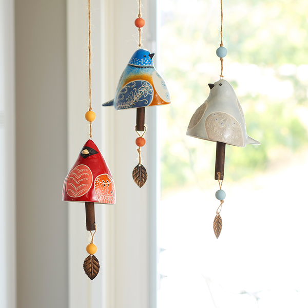 hanging bird windchimes by window