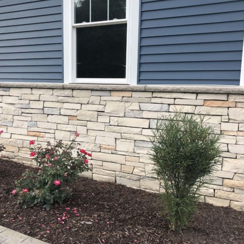 stone on front of home