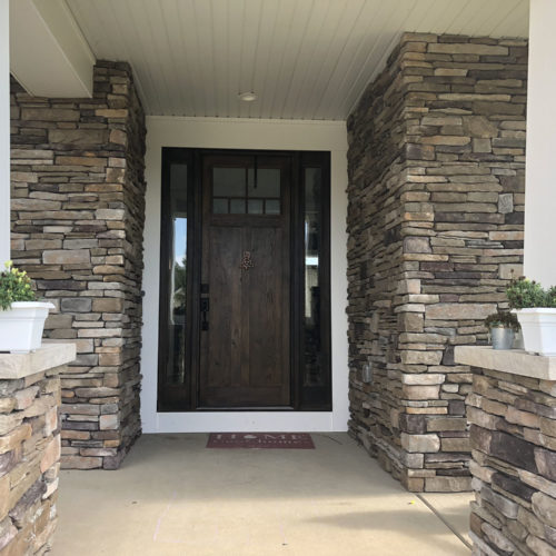 stone entranceway to home with stones from a landscaping supply store
