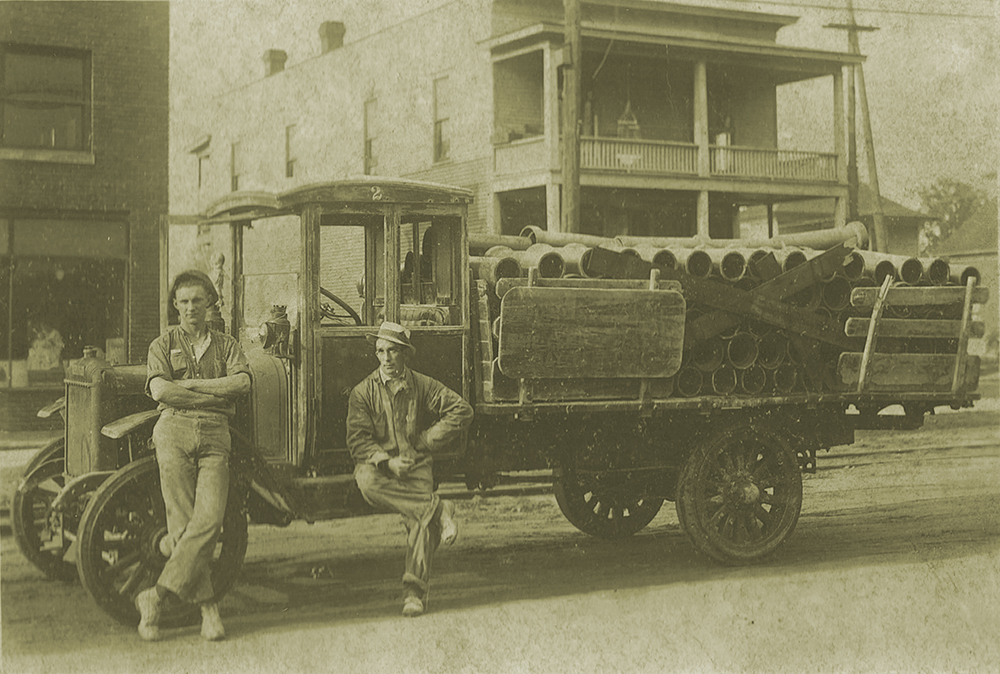 old photograph of young bros & daley truck and workers