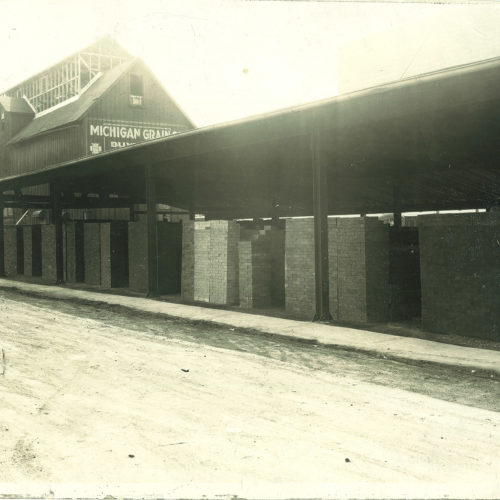 old photograph of young bros & daley supply location with brick and stone