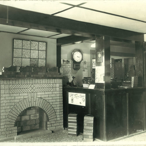 old photograph of young bros & daley showroom with fireplace
