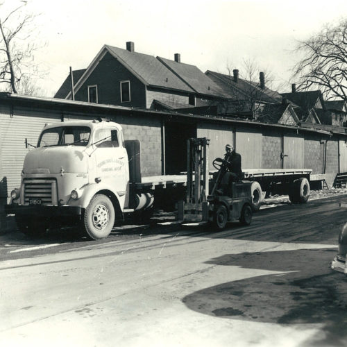 old photograph of young bros & daley truck and worker