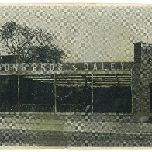 old newspaper clipping with image of Young Bros & Daley storefront