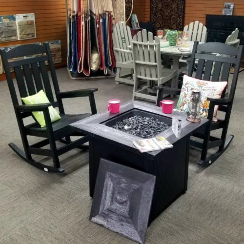 showroom display of outdoor fire pit tables