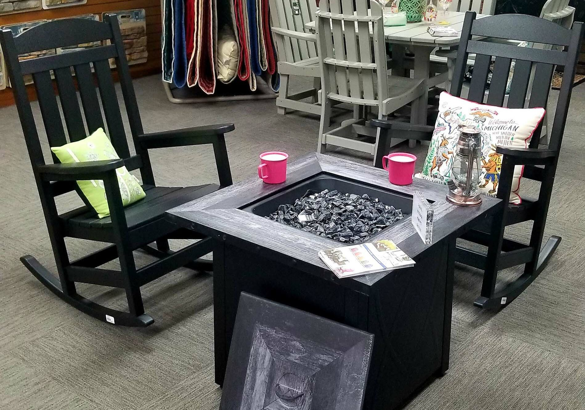 showroom display of outdoor fire pit tables at landscaping supply store