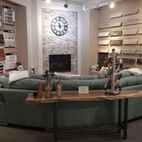 showroom display of living room furniture and tile flooring