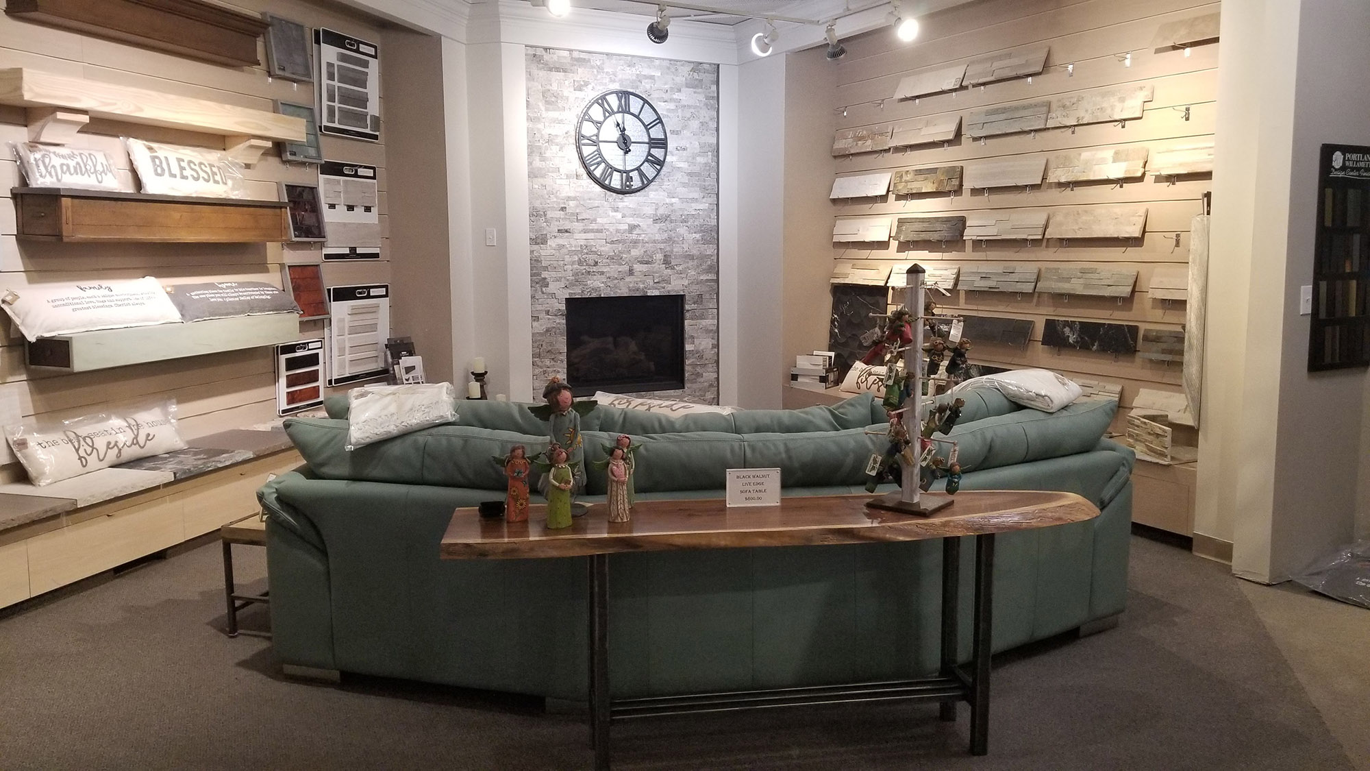 showroom display of living room furniture and tile flooring at landscaping supply store