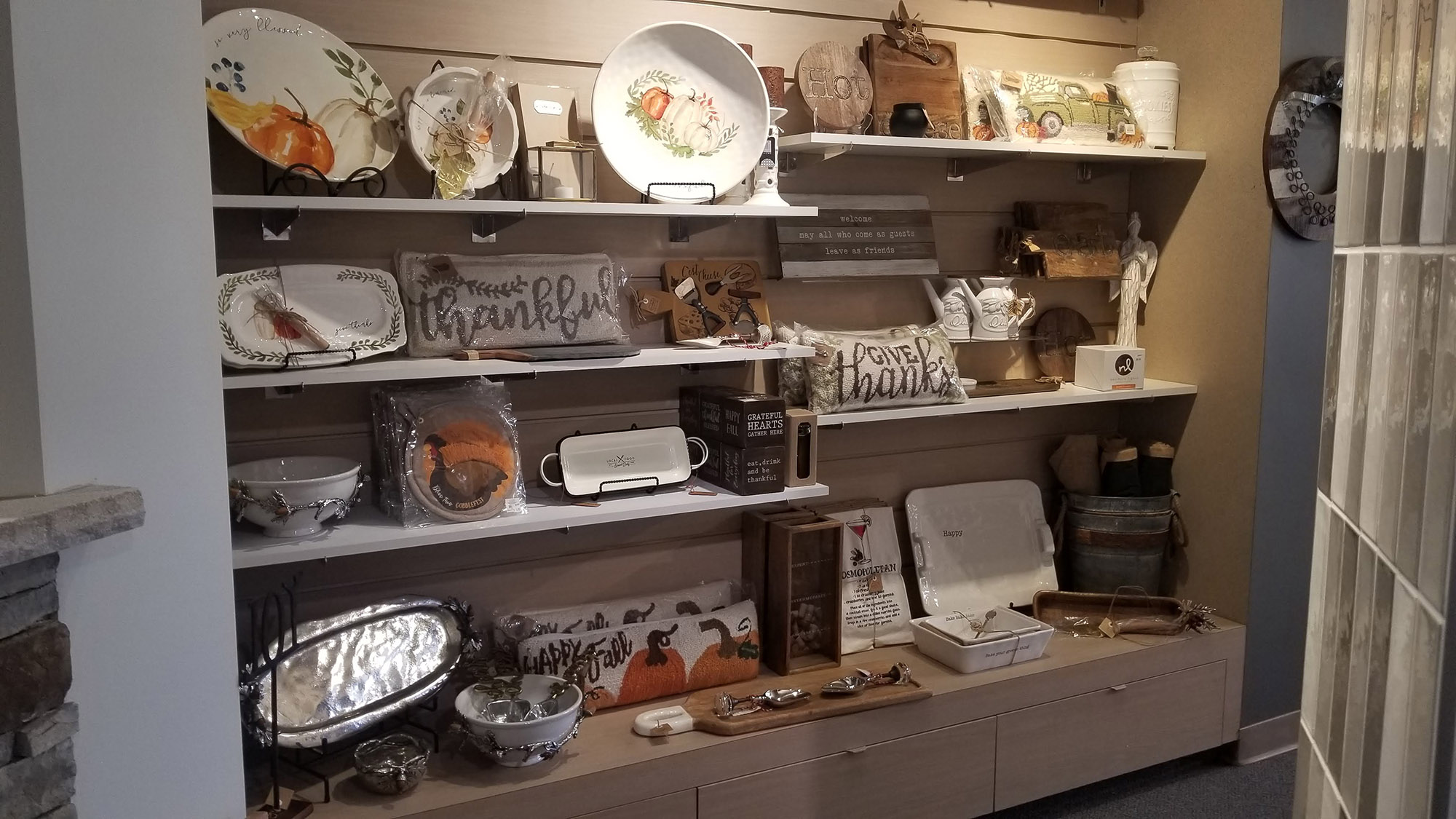 showroom display of Thanksgiving home furnishings and decor at landscaping supply store