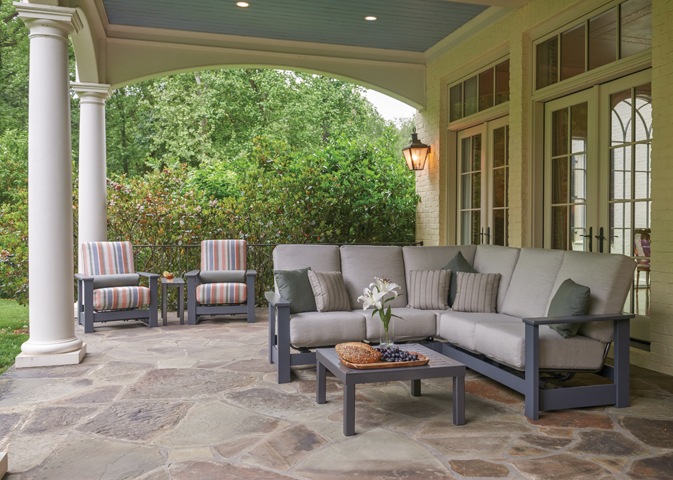 all weather patio furniture display and stone flooring at building material supplier store